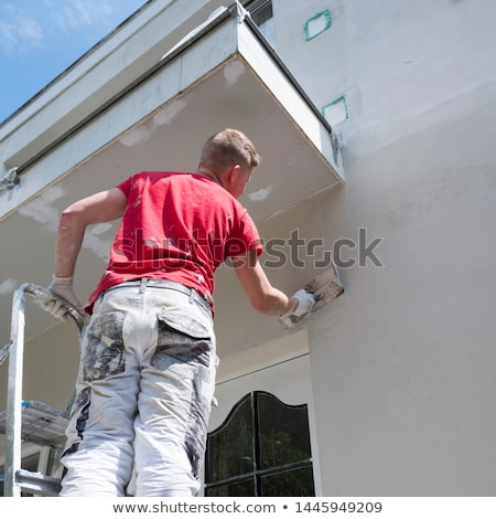 yeso · trabajador · de · trabajo · pared · casa - foto stock © kzenon