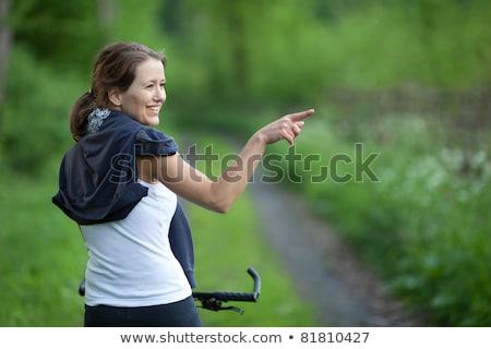 Csinos fiatal női motoros kint hegyi kerékpár Stock fotó © lightpoet