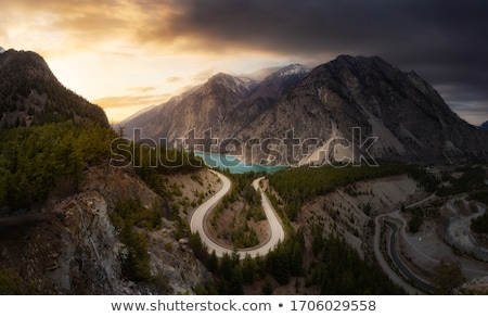 Aerial view of the road in mountain valley at sunset in spring Stock photo © denbelitsky