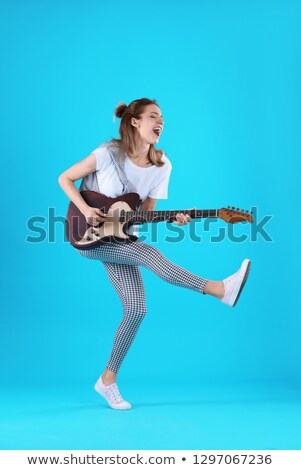 Full length talented girl playing electric guitar Stock photo © Giulio_Fornasar