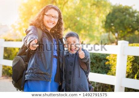 Hispanic Brother and Sister Wearing Backpacks With Thumbs Up Stock photo © feverpitch