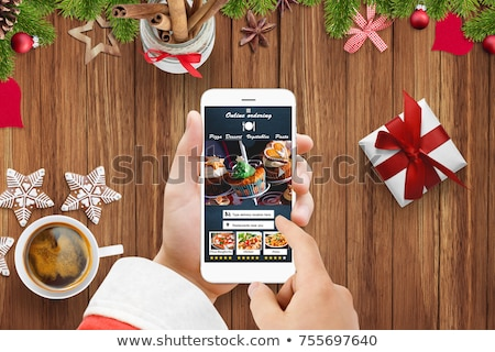 Santa Claus with Burger. Christmas menu fast food restaurant concept Stock photo © studiostoks