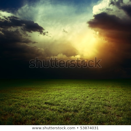 Dramatic storm sky with dark clouds and bright sunbeams Stock photo © vapi