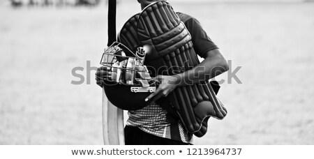 Cricket Player in Protective Helmet, Bat in Hand Stock photo © robuart