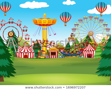 Themepark scene with many rides and balloons in the sky Stock photo © bluering