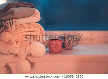 Mug and cozy plaids on window in night Stock photo © dashapetrenko