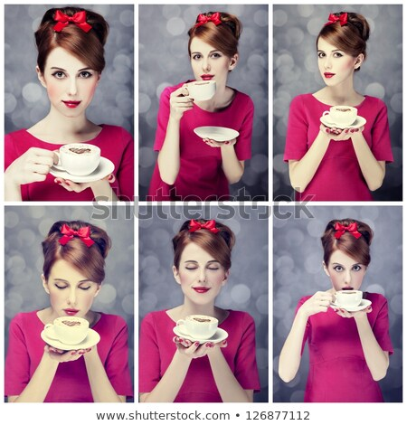 smiling young redhead woman in winter dress holding coffee cup stock photo © rob_stark
