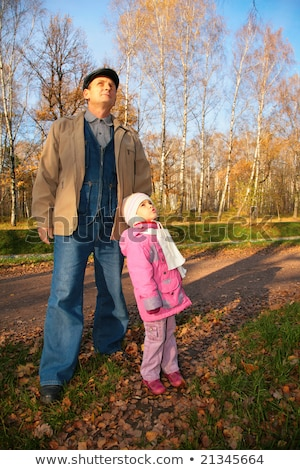 Grandfather with  granddaughter stand in park in autumn and look upward Stock photo © Paha_L