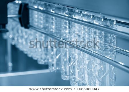 rows of empty plastic bottles at bottling plant stock photo © rufous