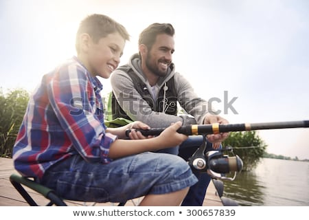 Syn ojca połowów jezioro rodziny człowiek szczęśliwy Zdjęcia stock © photography33