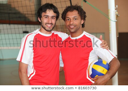 team mates stood with volley ball on indoor court stock photo © photography33