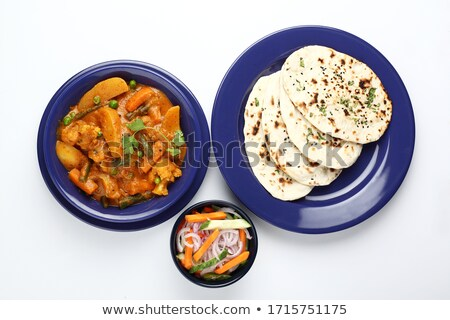 Traditional Indian bread chapati with curries, raitha Stock photo © mnsanthoshkumar