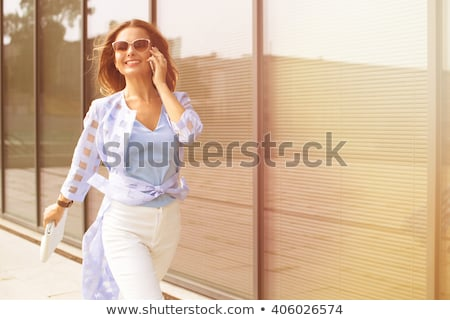 Stock photo: young confident woman is walking