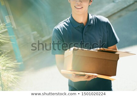Young courier delivering parcels Stock photo © photography33