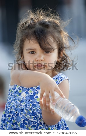 chocolate loving brunette cutie stock photo © lithian