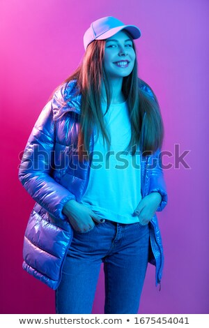 Trendy fashion woman in blue creative clothes and cap posing Stock photo © gromovataya
