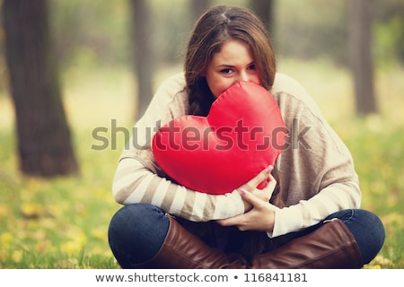 redhead girl with toy heart at autumn park stock photo © massonforstock