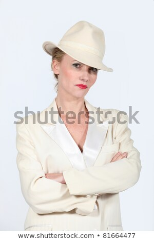 Woman stood arms folded wearing  a cream jacket and hat Stock photo © photography33