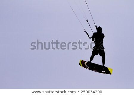 silhueta · pipa · surfista · saltando · ondas · céu - foto stock © acidgrey