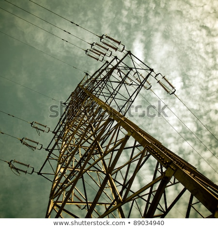electricity pylon against blue cloudy sky stock photo © olinkau