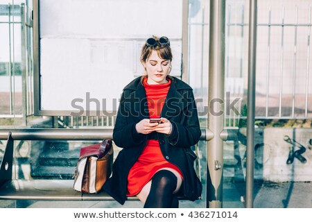 beautiful young woman in red dress with phone stock photo © kyolshin