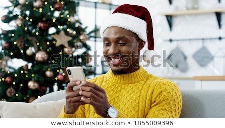 traditional male is happy with technology Stock photo © Pasiphae
