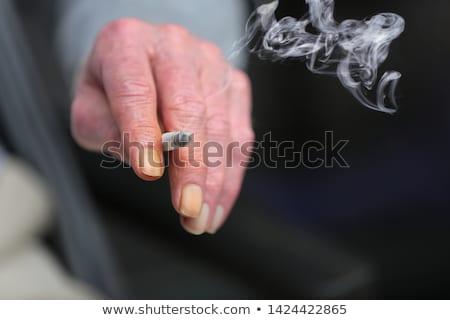Zincir sigara tiryakisi adam yatak sigara içme sağlık Stok fotoğraf © ongap