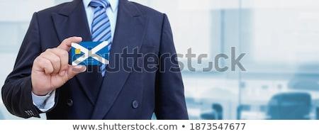üzletember tart névjegy Skócia zászló nemzetközi Stock fotó © stevanovicigor