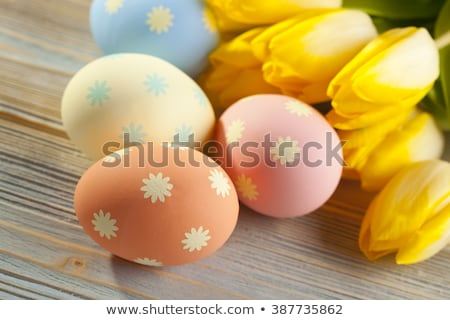 Happy Easter in four colors easter eggs with flowers Stock photo © marinini