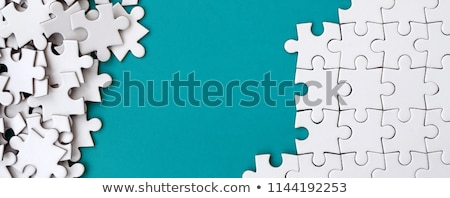 Incompleted white puzzle  Stock photo © leungchopan