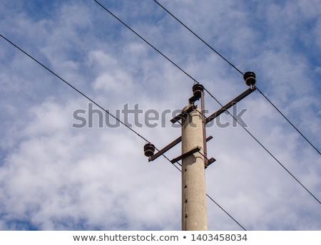 power pole with blue sky and white clouds stock photo © meinzahn