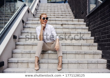 Sitting on stairs. stock photo © Fisher