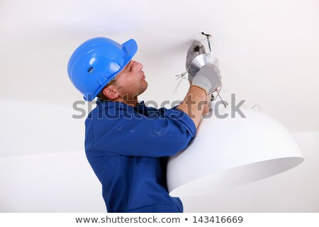 Electrician Installing Light Fitting In Home Stock photo © monkey_business