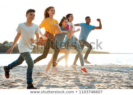 подростков играет пляж лет студентов песок Сток-фото © monkey_business