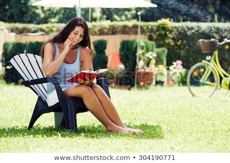 pensive young casual man sitting on a chair outdoor stock photo © feedough