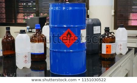 Bottle of chemical liquid with hazard symbol Stock photo © stevanovicigor