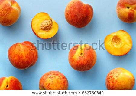 nectarines on blue background stock photo © dariazu