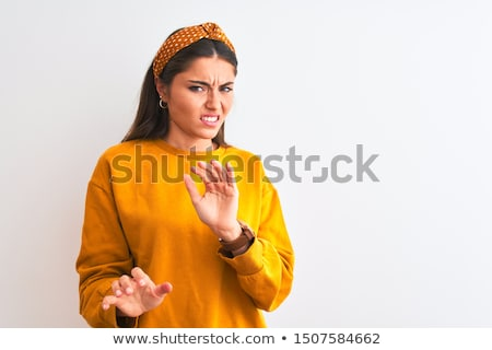 Jonge vrouw walgelijk gezicht portret mooie vrouwen Stockfoto © iko