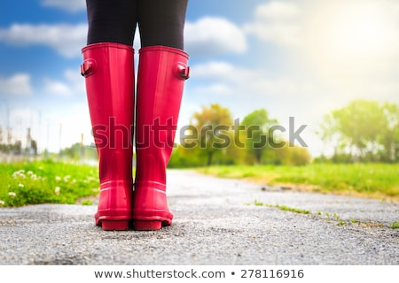 woman wearing rubber boots in spring nature Stock photo © phbcz