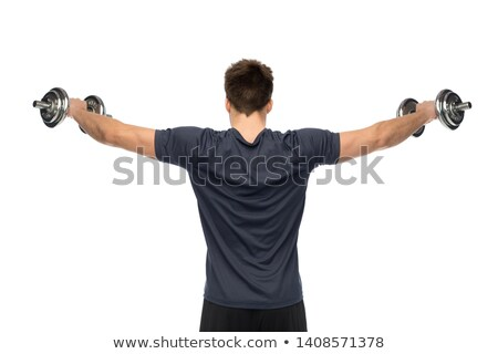Rear view of a young man holding out dumbbell Stock photo © wavebreak_media