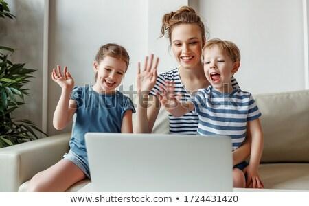 Testvérek ül kanapé laptopot használ otthon nappali Stock fotó © wavebreak_media