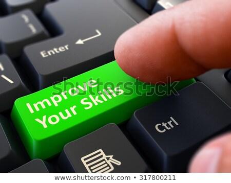 Finger Presses Green Keyboard Button Improve Your Skills. Stock photo © tashatuvango