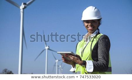 Female at wind power generator stock photo © jordanrusev