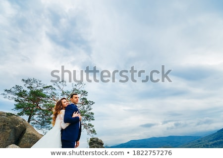 bride embraces fiance against the background of the sky Stock photo © Paha_L