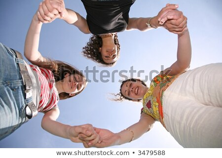 Three girlfriends have risen in a circle Stock photo © Paha_L