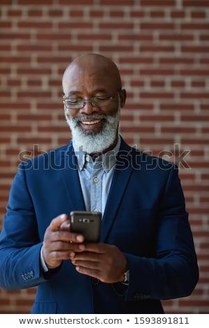 aantrekkelijk · zakenman · permanente · zwart · pak - stockfoto © deandrobot