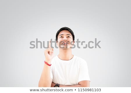 young smiling man having a good idea stock photo © patramansky