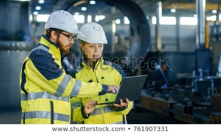 Işçiler kask çelik odak ileri sanayi Stok fotoğraf © shime