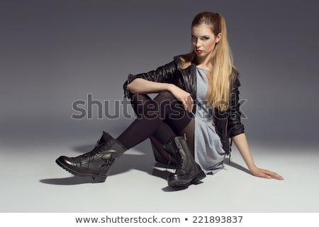 Csábító fiatal nő fekete ruha ül pózol portré Stock fotó © deandrobot