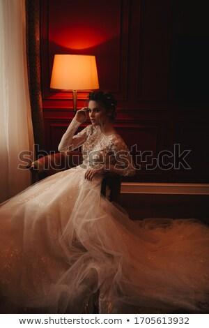 Pretty woman in white robe near wall Stock photo © dash